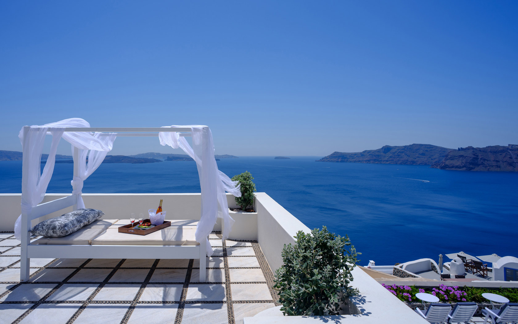 Nikos Villas Santorini - Relax moments by the pool